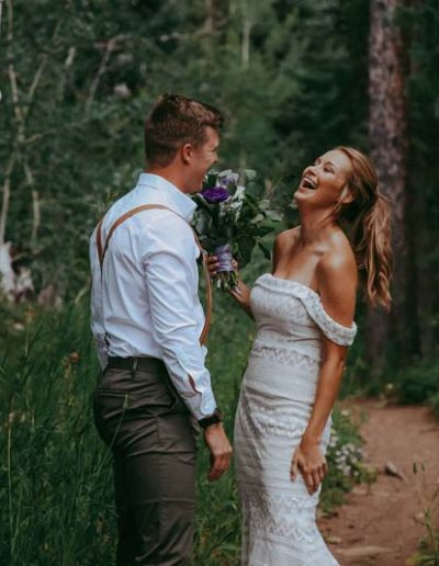 wedding couple laughing in aspen grove