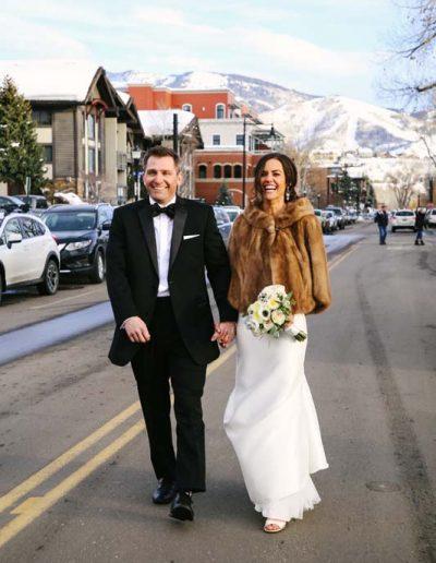 wedding couple walking down main street steamboat springs