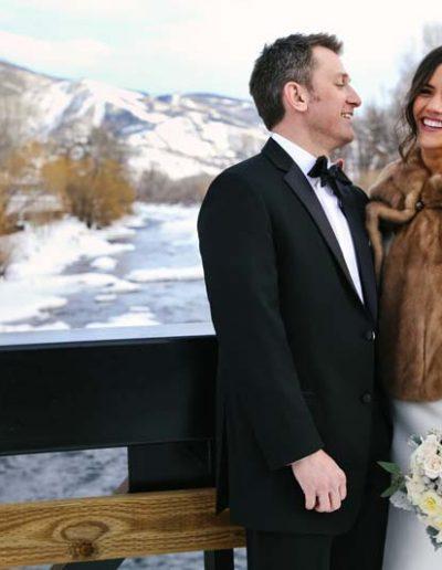 happy wedding couple outdoors wintertime