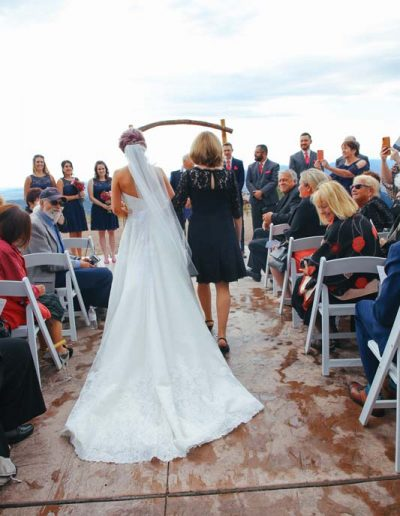 mom walking bride down the aisle
