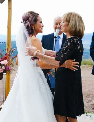 bride with mom at wedding