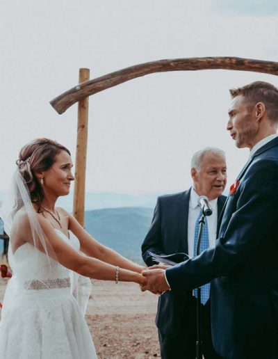 couple exchanging vows outdoors steamboat springs