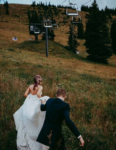 wedding couple at steamboat springs resort under chair lift