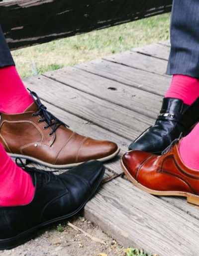 grooms with pink socks