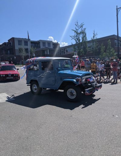 Old Toyota Land cruiser decorated for parade.