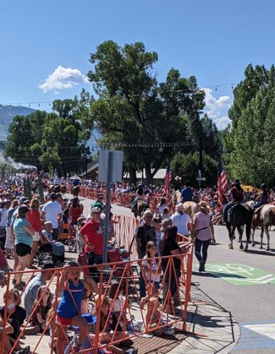 People lining the street for 4th of July Parade.