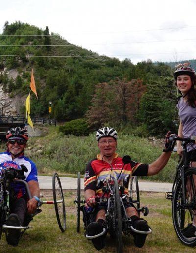 Adaptive bikes with riders.